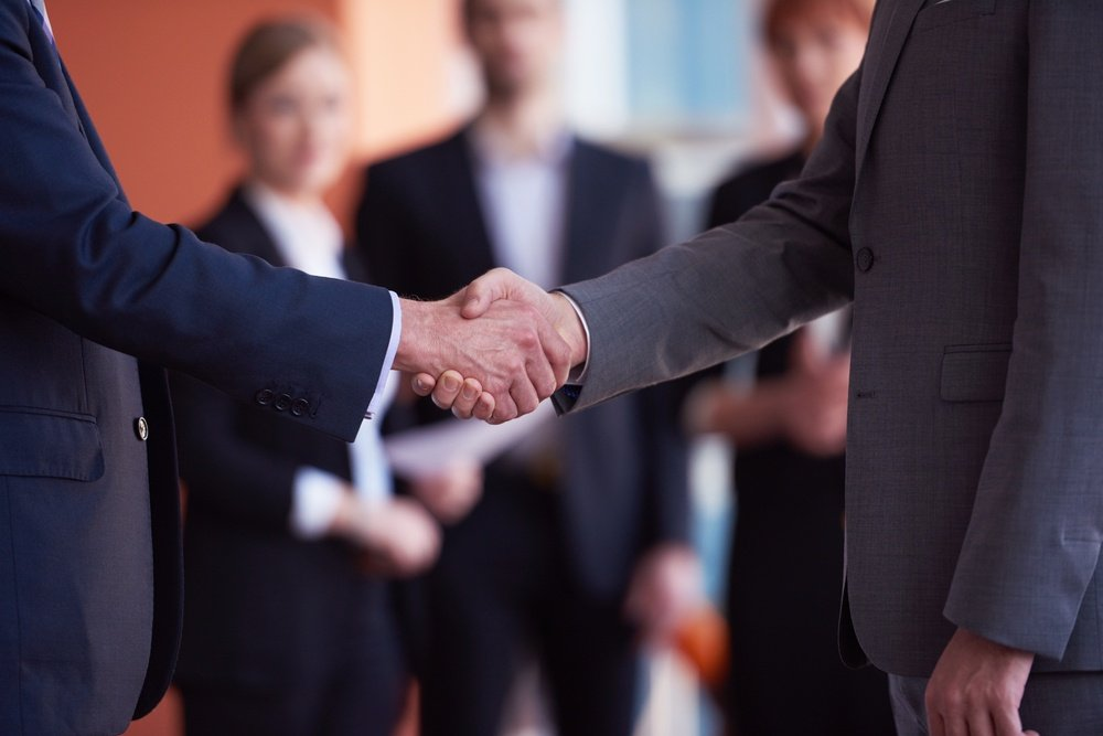 business partners, partnership concept with two businessman handshake-1.jpeg